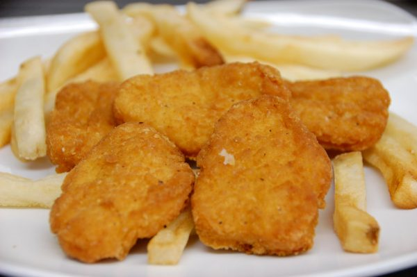 Chicken nuggets and chips on plate